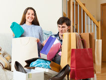 Guy and girl be delighted purchases. In home Stock Images