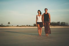 Loving couple on the beach watching the sunset royalty free stock photos