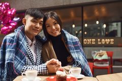 Guy with girl in cafe at table. Royalty Free Stock Photos