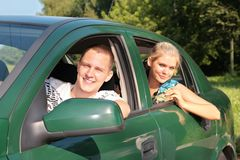 Guy and girl in car Royalty Free Stock Photo