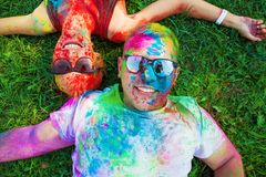 Guy with a girl celebrate holi festival, make selfie. Fun on holiday royalty free stock photos