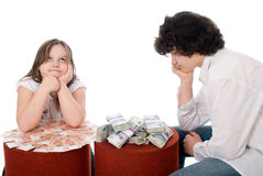 Guy with girl consider a lot of money Royalty Free Stock Image