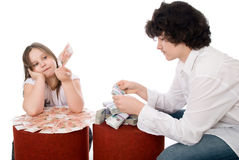 Guy with girl consider a lot of money Stock Photo
