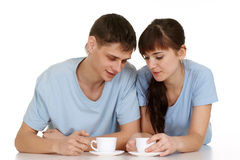 A guy and a girl with a cup lying Royalty Free Stock Photo