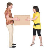 Guy and the girl divide big box. The guy and the girl divide one big box royalty free stock photography