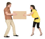 Guy and the girl divide big box. The guy and the girl divide one big box stock photos