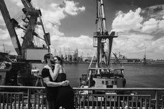 Guy and girl in the docks Stock Photo