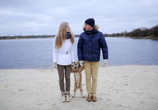 Guy, girl and dog Royalty Free Stock Images