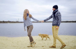 Guy, girl and dog stock photography