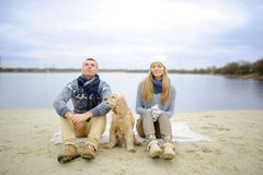 Guy, girl and dog royalty free stock image