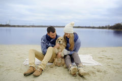 Guy, girl and dog royalty free stock photography