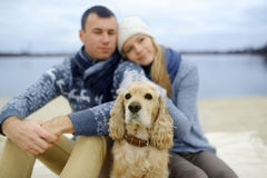 Guy, girl and dog stock photos