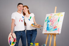 The guy and the girl draw paints Royalty Free Stock Photos