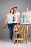 The guy and the girl draw paints Stock Photography