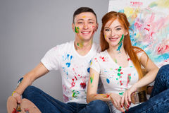 Guy and the girl draw paints Stock Photography