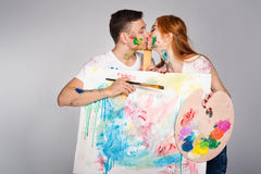 The guy and the girl draw paints Royalty Free Stock Photography