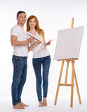 Guy and the girl draw paints Royalty Free Stock Photography