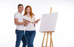 Guy and the girl draw paints Royalty Free Stock Image