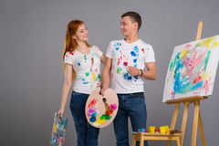 Guy and the girl draw paints Stock Photos