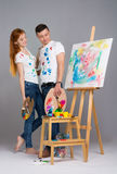 The guy and the girl draw paints Stock Photo