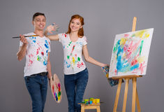 Guy and the girl draw paints Stock Image