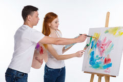 Guy and the girl draw paints Royalty Free Stock Images