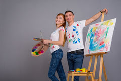Guy and the girl draw paints Stock Images
