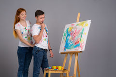 Guy and the girl draw paints Royalty Free Stock Photos