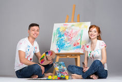 The guy and the girl draw paints Royalty Free Stock Images