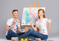 The guy and the girl draw paints Stock Images