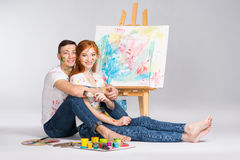 The guy and the girl draw paints. On the easel Royalty Free Stock Photos
