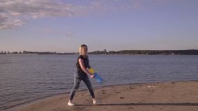 The guy with the girl enjoy weather at the sea. Water gun. On the ey video you can as the young couple walks on the beach from watersyany guns. Beautiful young stock video