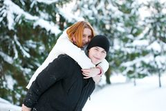 Guy and the girl enjoy winter walk Stock Image