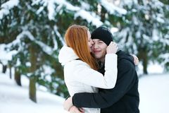 Guy and the girl enjoy winter walk Stock Images