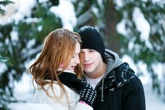 Guy and the girl enjoy winter walk Royalty Free Stock Images