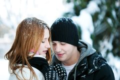 Guy and the girl enjoy winter walk Royalty Free Stock Photography