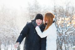 Guy and the girl enjoy winter walk Royalty Free Stock Image