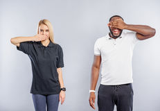 Guy and girl expressing their emotions by gestures Stock Photography