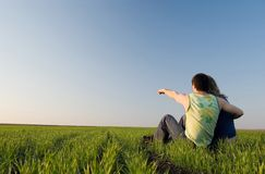 Guy and girl in the field Royalty Free Stock Images