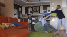 Guy and girl fight with pillows stock video