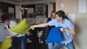 Guy and girl fight with pillows stock footage