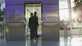 The guy and the girl are going to the elevator and going down. stock footage