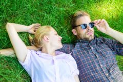 Guy and girl happy carefree enjoy freshness of grass. Closer to nature. Couple in love relaxing lay at meadow. Nature royalty free stock image