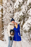 The guy and the girl have a rest in the winter woods. Royalty Free Stock Photography
