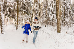 The guy and the girl have a rest in the winter woods. Royalty Free Stock Photo