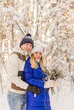 The guy and the girl have a rest in the winter woods. Royalty Free Stock Image