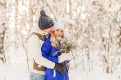 The guy and the girl have a rest in the winter woods. Royalty Free Stock Images