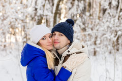 The guy and the girl have a rest in the winter woods. Stock Image