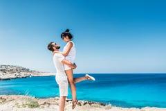 Guy and girl having fun on the sea royalty free stock photo