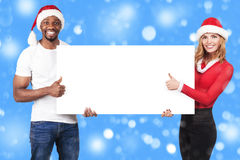 Guy and girl holding a white board with empty copy space for gre Royalty Free Stock Photography